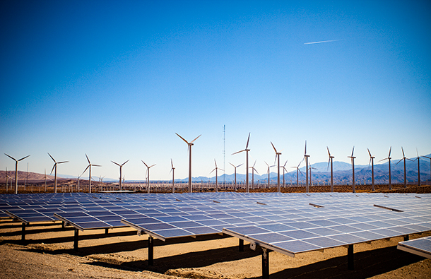 Solar panels and wind turbines in the desert