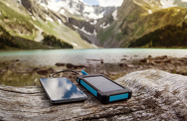 solar power phone charger in an outdoor landscape
