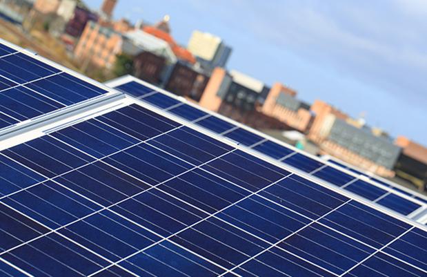 Solar panels in a city. Community Solar. Community Solar Farm.