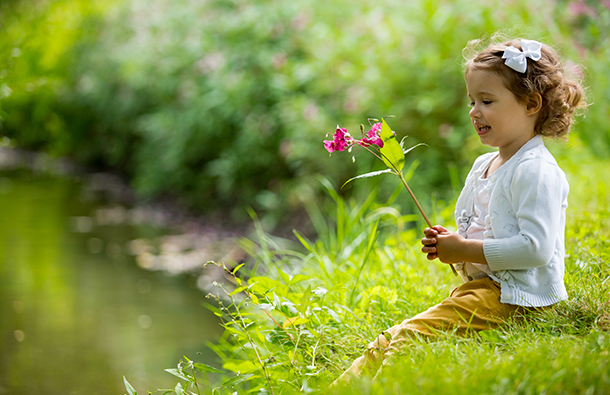 girl with flower in nature