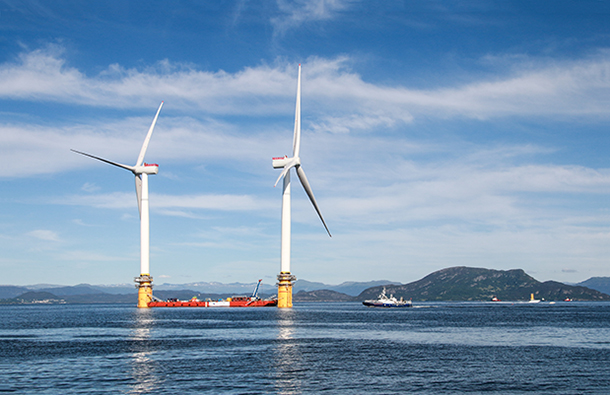 Floating wind farm turbines being taken to the seas of Scotland