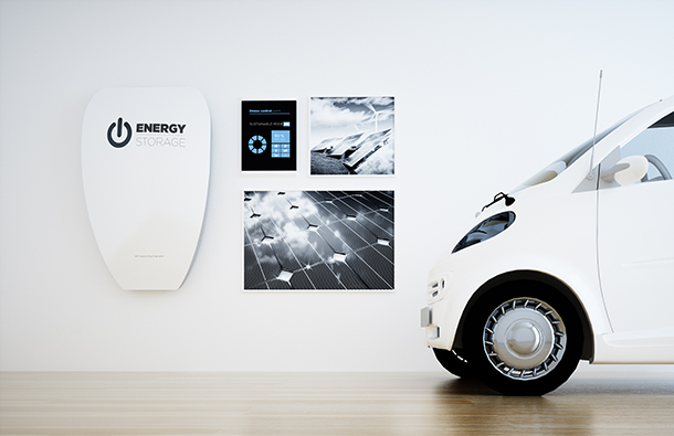 Home battery powered by solar next to electric vehicle