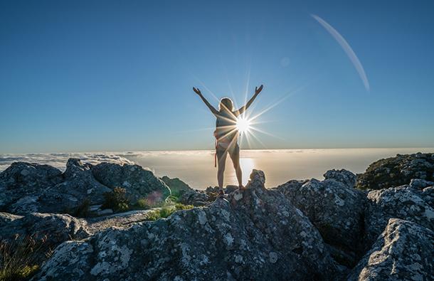 Woman celebrating on a mountain top