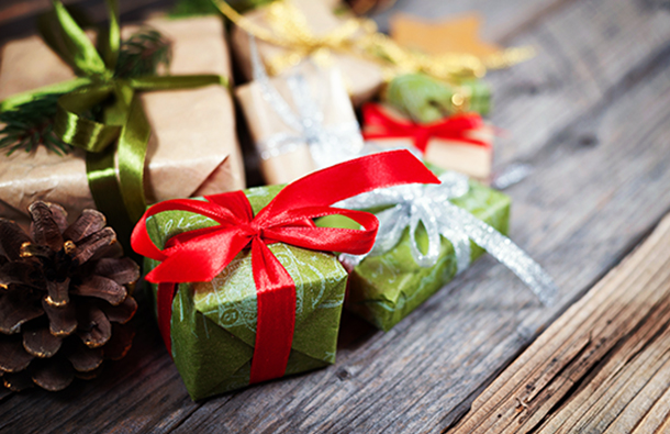 holiday gifts with green wrapping paper