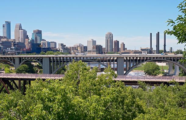Minneapolis, Minnesota skyline with bridges and trees