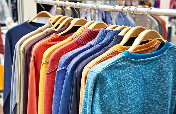 Colorful clothes hanging on a clothing store rack