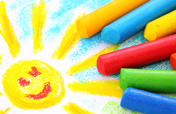 Kid's colorful drawing of the sun shining