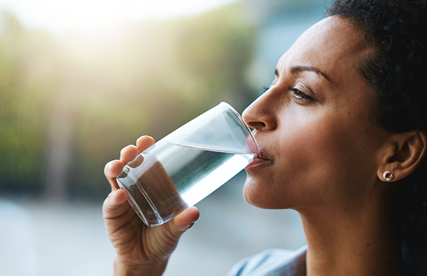 woman drinking a clean glass of water