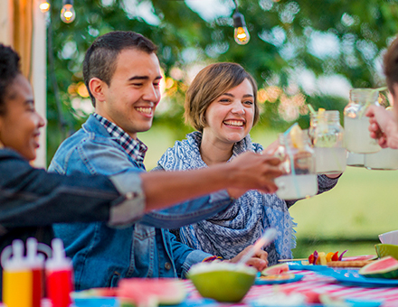 Summer porch fun with friends toasting lemonades to stay cool