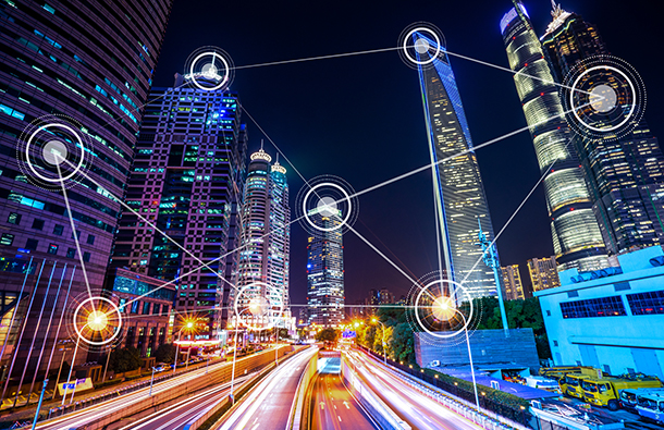 A modern smart city at night connected by the Internet of Things (IoT)