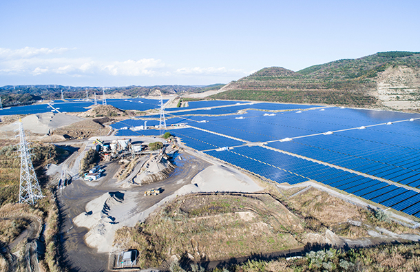 Aerial view of a large industrial area that is now being used as a solar farm.