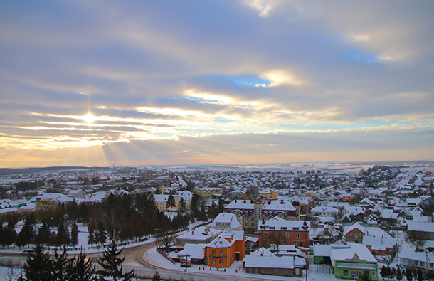 Aerial shot of a small town at winter with a cloudy dramatic sky during the day