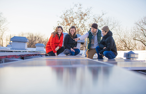 CleanChoice staff and DC Solar Farm partner New Columbia Solar on rooftop solar installation