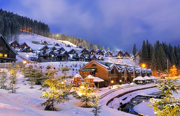 Idyllic night scene of a snowy neighborhood in the mountains