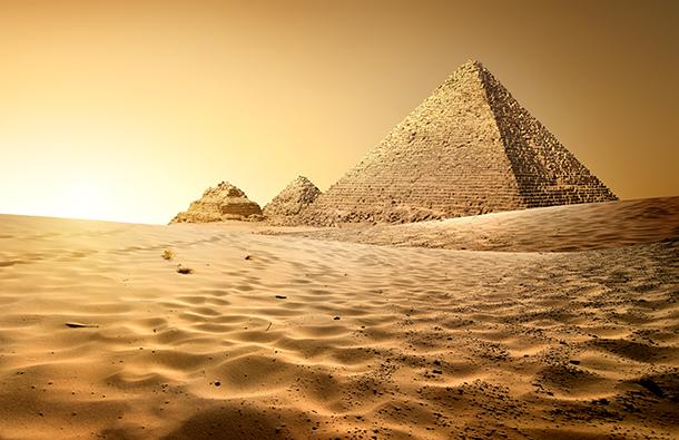 Sun rising over the pyramids