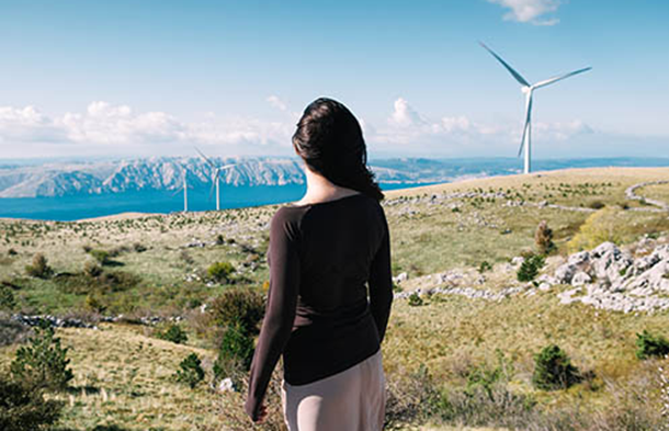 Woman looking at clean energy