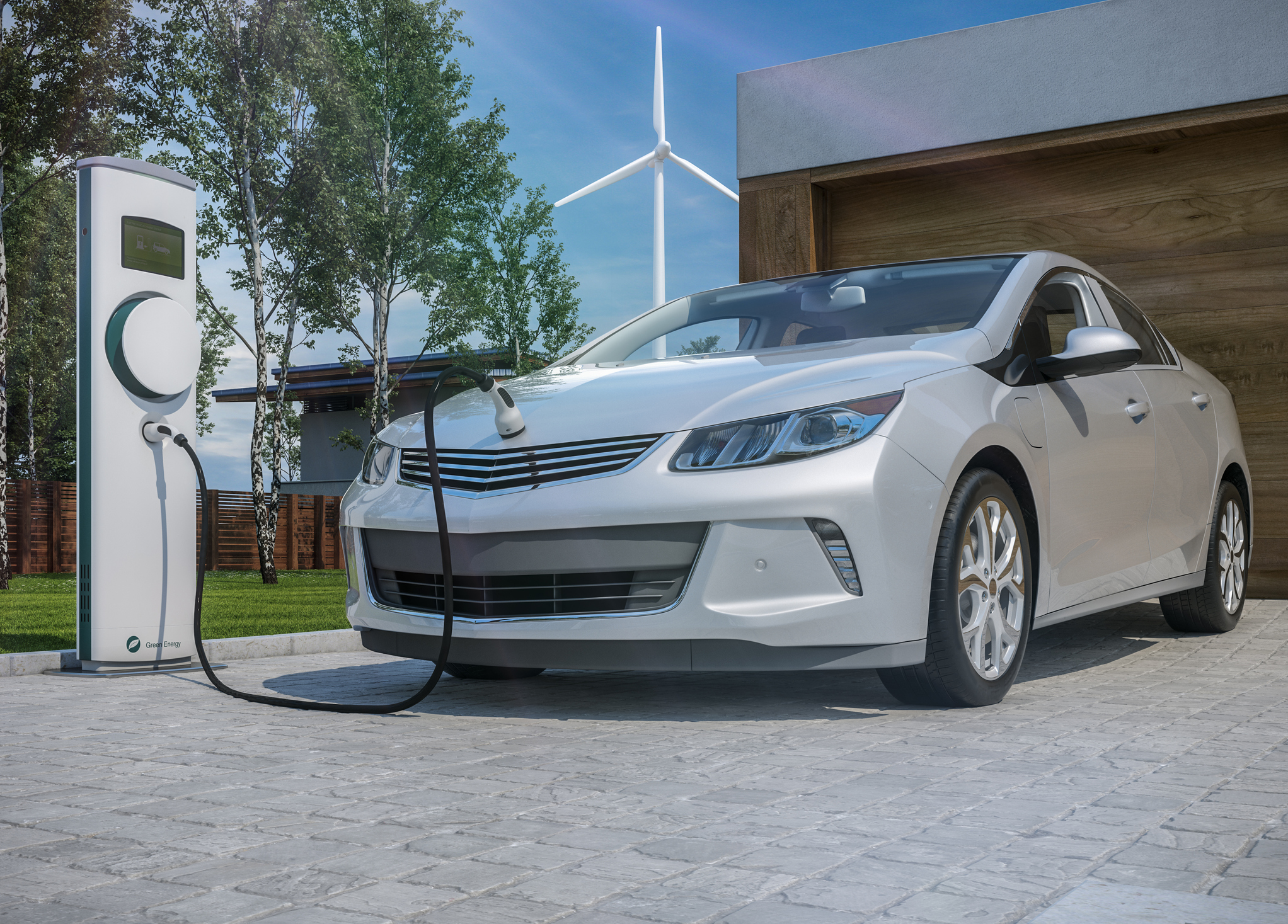 Electric vehicle charging in a driveway.