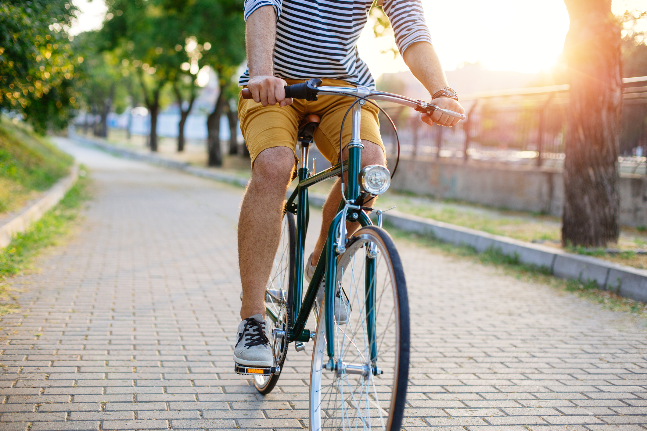 Person riding a bike on a sunny day.
